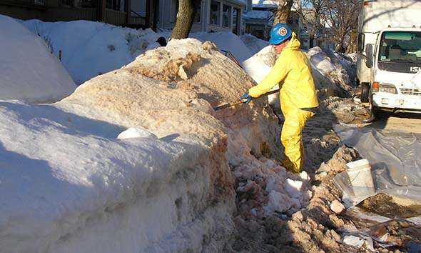 CommTank crew shovel contaminated snow from the street and melt it in a steel temp tank.