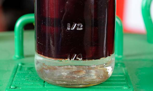 Generator diesel fuel sample with water at the bottom