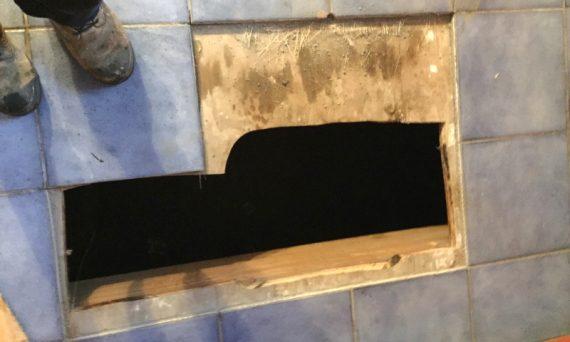 Underground tank located under kitchen floor