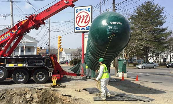 Underground tank installation at a gas station in Massachusetts