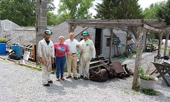 Kevin Hoag and Gail Prince stand outside the farm stand after the boiler removal.