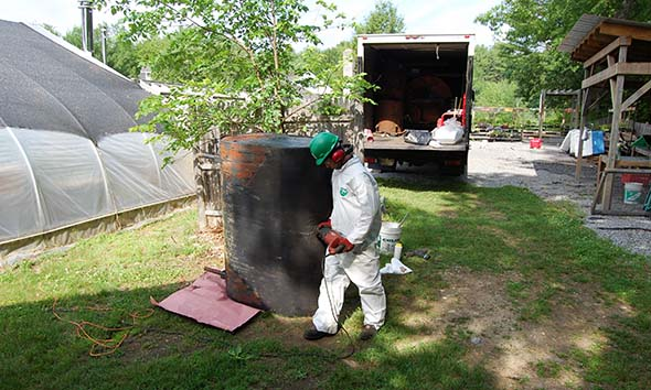 CommTank technician is cutting the oil tank that used to supply the greenhouse boiler.