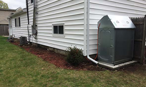 Roth heating oil tank installed outside a home