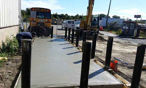 Aboveground tank pad with steel bollards