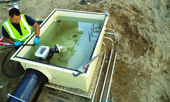 Technician is performing a hydrostatic test on a UST sump