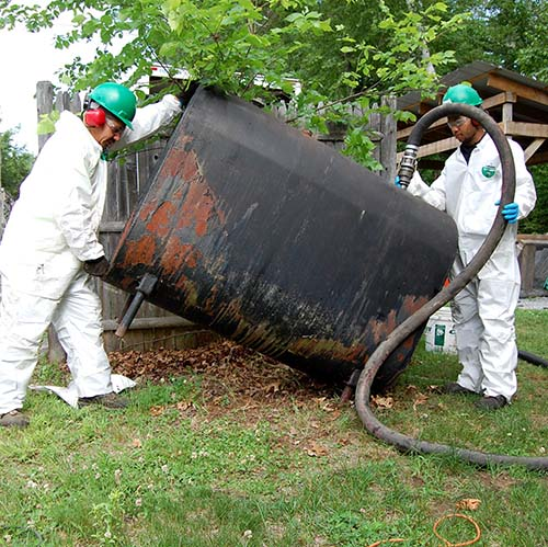 Removing oil from outdoor tank in Bedford, NH.