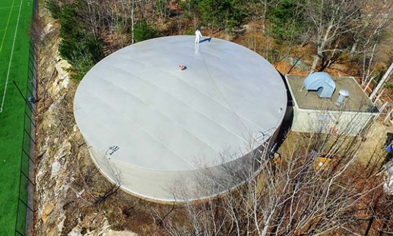CommTank crew apply a final coat of epoxy to the roof of this water storage tank