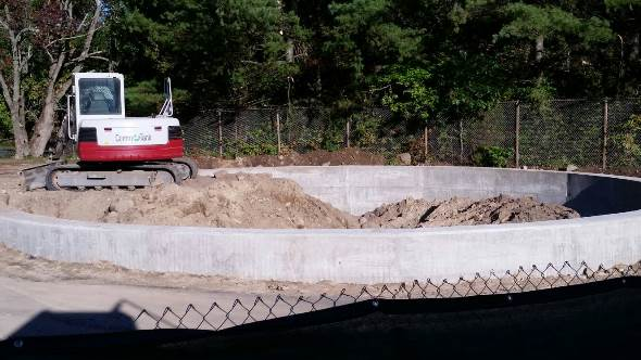 Photo of crew backfilling an aboveground storage tank foundation