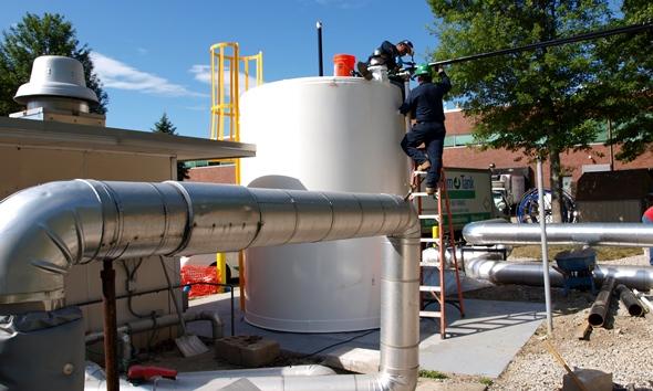 CommTank crew installing fuel lines to diesel generator