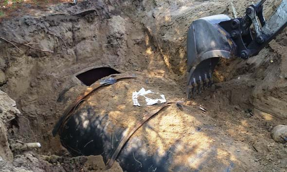 Underground storage tank cut open for cleaning