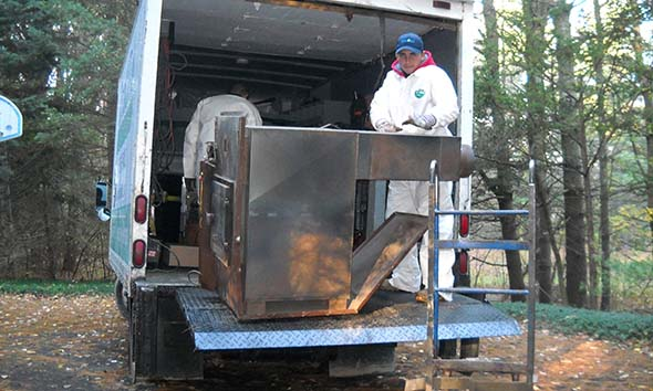 The furnace is loaded on the truck and ready to be recycled.