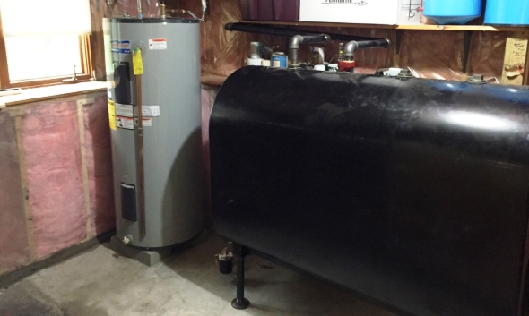 Oil tank and hot water tank back in place after stain removal