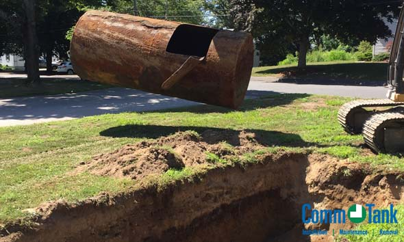 In ground oil tank is removed from the front yard of this home.