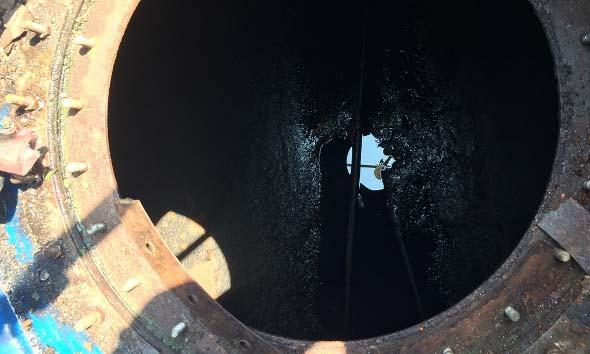 Sludge accumulation on the underground tank bottom