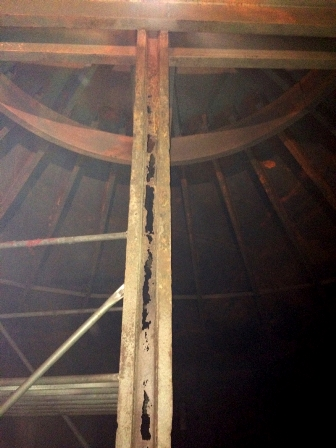 Photo showing uniform corrosion of a steel beam roof support for an aboveground tank