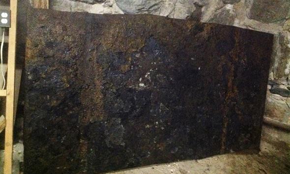 Side-wall of leaking oil storage tank