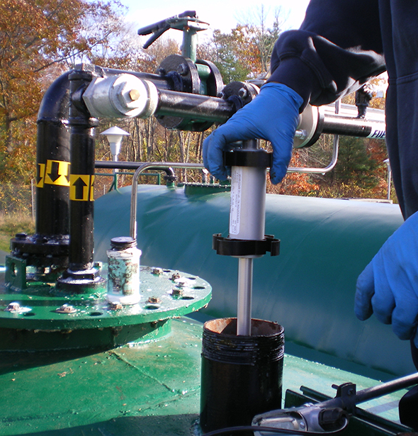 Photo of an automatic tank gauge probe being installed in an aboveground storage tank.