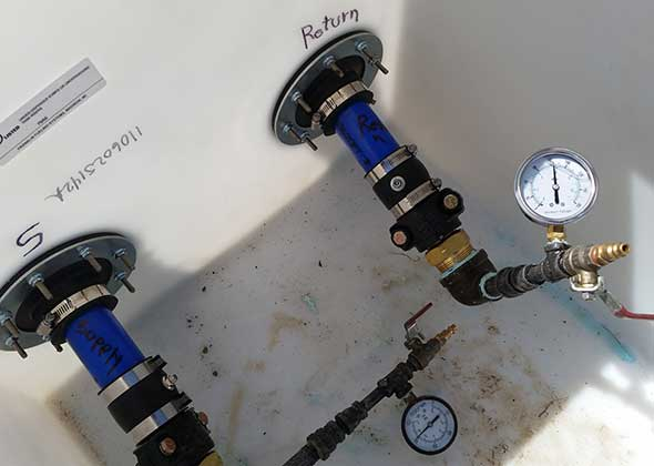 Photo of OPW flexible pipe connection testing in tank sump.