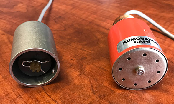Photo of a Veeder-Root and Omntec sensor.