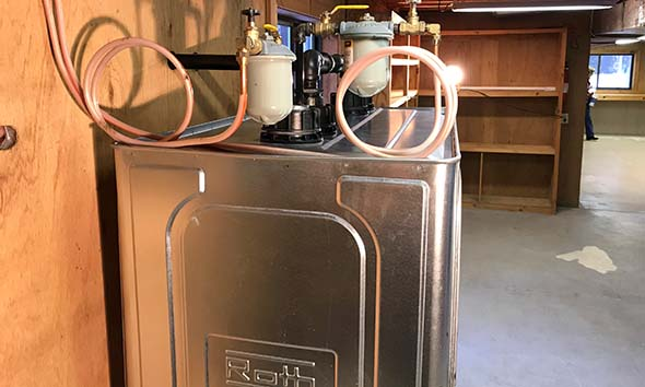 Fuel filters for a furnace and water heater are installed on top of Roth oil tank