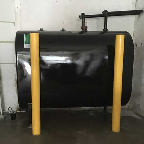 Photo of oil tank replacement in garage with bollards.