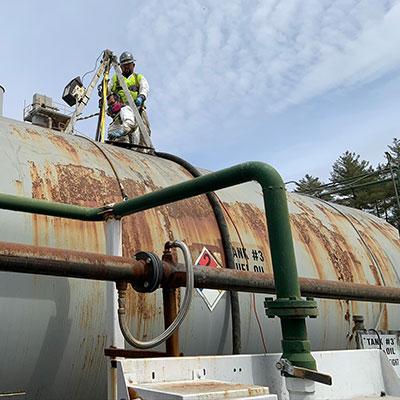 Fuel inspectors in on tank in Massachusetts.